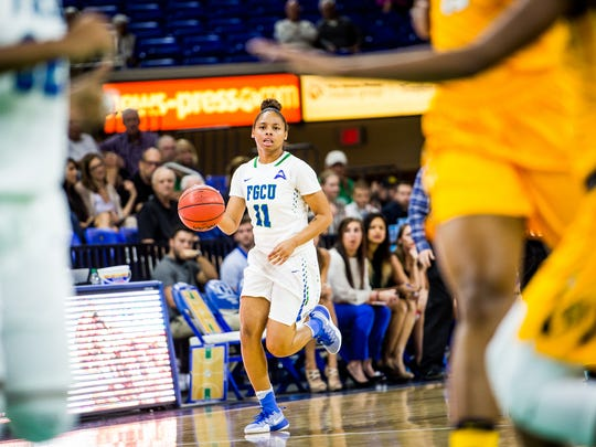 Florida Gulf Coast University's Erica Nelson brings the ball up court during a game against North Carolina A&T at Alico Arena in Fort Myers, Fla., on Wednesday, Dec. 14, 2016.