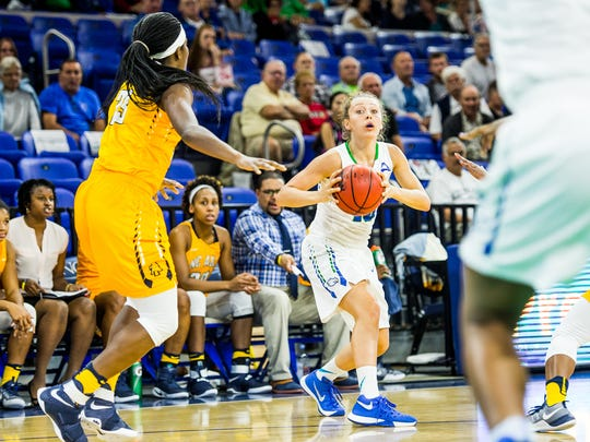 Florida Gulf Coast University's Tayler Goodall looks to pass the ball during a game against North Carolina A&T at Alico Arena in Fort Myers, Fla., on Wednesday, Dec. 14, 2016.