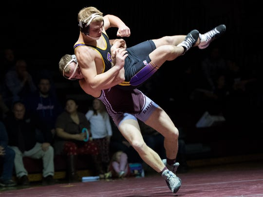 Shippensburg's Levi Shoemaker throws Boiling Springs' Nick Kostyak in a 170-pound bout on Thursday, Dec. 15, 2016 at Shippensburg High School. Kostyak won 4-1, but Ship took a 33-30 victory.