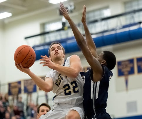 Greencastle-Antrim's Casey Hoover, left, is just 12 points away from hitting 1,000 on his career with the Blue Devils.