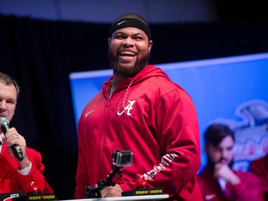 "Alabama linebacker Ryan Anderson (22) smiles while competing in ""Football Feud"" during the Peach Bowl Team Welcome Dinner on Dec. 28, 2016, at the College Football Hall of Fame in Atlanta."