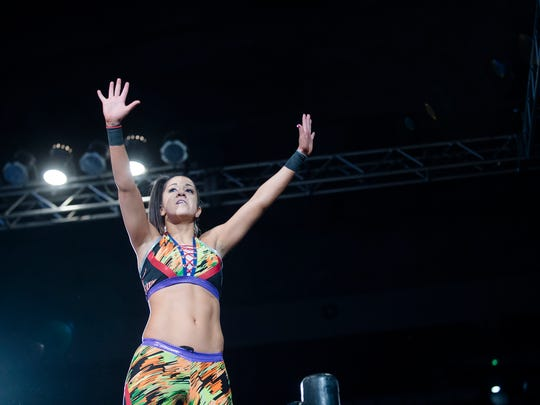 Bayley waives to fans during the WWE Raw Live performance at the Garrett Coliseum in Montgomery, Ala., on Saturday, Jan. 7, 2017.