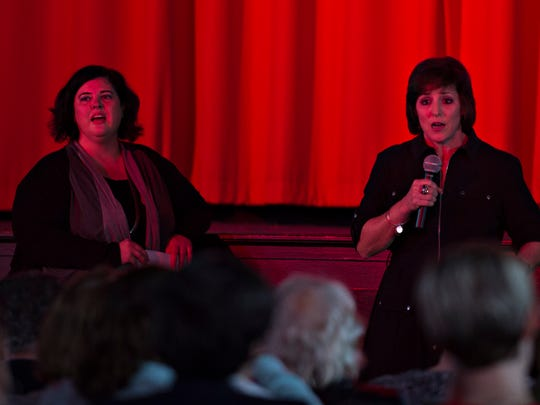 Sara Ramano, right, and Kacey Keeton speak before presenting a documentary on a death row inmate at the Faith & Justice: A Conversation evening at the Capri Theatre on Thursday, Jan. 12, 2017, in Montgomery, Ala. Sara Ramano and Kacey Keeton are with the Federal Defender's office for the Middle District of Alabama. Keeton is the attorney for Rocky Myers, Ramano is the investigator on his case.