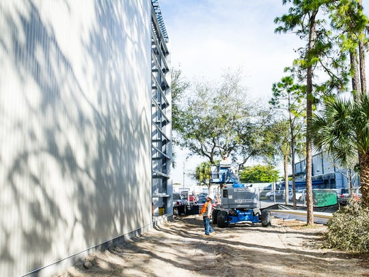 Roberto Rae helps with the construction of a warehouse expansion at William C. Huff in Naples, Fla., on Wednesday, Jan. 18, 2017. William C. Huff, high-end moving and storage, is expanding its warehouse capacity and has installed a large solar power system.