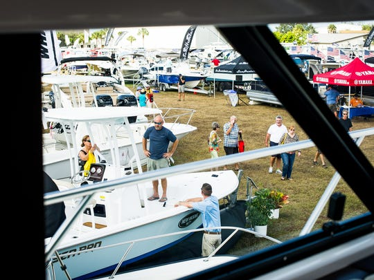 People shop and dream about boats at the 50th annual Naples Boat Show at Naples Municipal Airport on Sunday, Jan. 22, 2017.