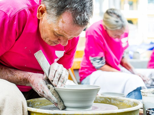 Danny Ripka makes a bowl during the annual Empty Bowls Naples fundraiser in Naples, Fla., Saturday, Jan. 28, 2017. A record-setting 3,000 bowls, all created by volunteers, will hold 50 varieties of hot soups contributed by local restaurants and country clubs for the annual Empty Bowls Naples fundraiser Saturday to feed Southwest Florida's hungry.