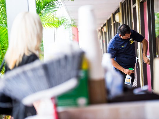 Daniel Reyes cleans the door of a room of the Ramada Inn in Naples, Fla., on Thursday, Jan. 26, 2017. Collier County runs a public schools program that places special needs kids in places of business to work a few hours a week to give them some job experience.