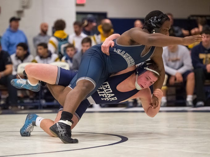 Cedar Cliff's Donovon Ball, bottom, wrestles with Chambersburg's