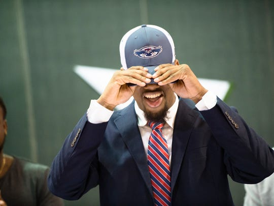 Jeff Davis Zion Gilbert puts on a Florida Atlantic hat before signing a letter of intent Jeff on National Signing Day, Wednesday, Feb. 1, 2017 in Montgomery, Ala.