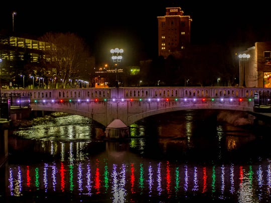 Downtown Battle Creek is aglow with lights. Meet with Santa at the downtown Warming House each week.