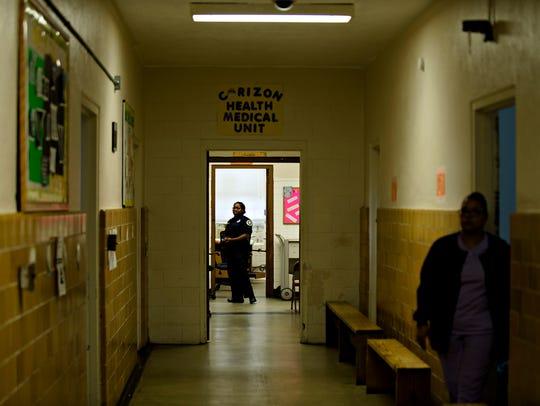 A prison guard looks down a corridor inside the Heath