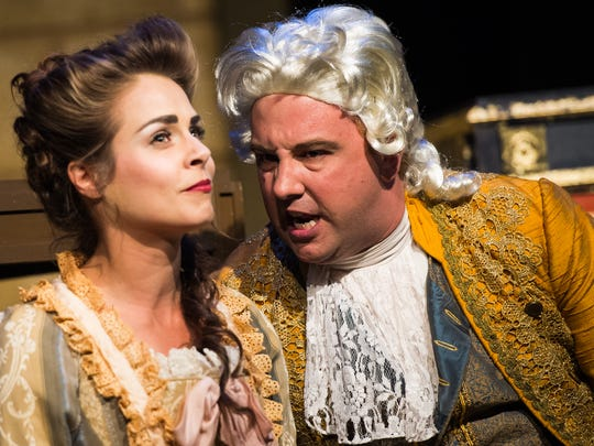 """Adolpho Blaire, right, acts out a scene with Kelly Pekar during a dress rehearsal at the G&L Theatre in Naples, Fla., on Monday, Feb. 6, 2017. TheatreZone is producing """"Amadeus,"""" the fictional account of composer Antonio Salieri's rivalry with, undermining his admiration for, another court composer, the iconoclastic, and somewhat crude, Wolfgang Amadeus Mozart."""