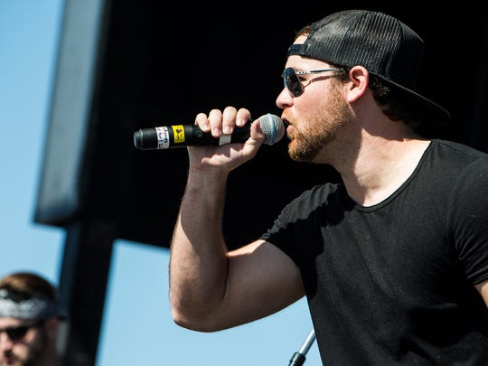 Garret Speer performs during the Everglades Seafood Festival in Evergaldes City, Fla., on Saturday, Feb. 11, 2017. The Everglades Seafood Festival is an annual event with lots of music, food, and various rides.
