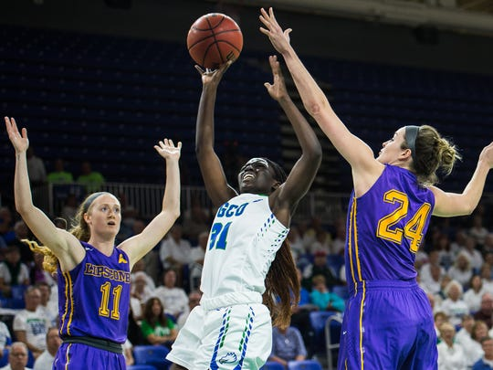 Florida Gulf Coast University's Nasrin Ulel goes up against Lipscomb's Alex Banks(24) on a tip off during a game at Alico Arena in Fort Myers, Fla., on Monday, Feb. 13, 2017.