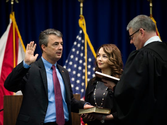 Steve Marshall takes the oath of office becoming the Alabama Attorney General as his wife, Bridgette Marshall, holds the bible on Monday, Feb. 13, 2017 in Montgomery, Ala.