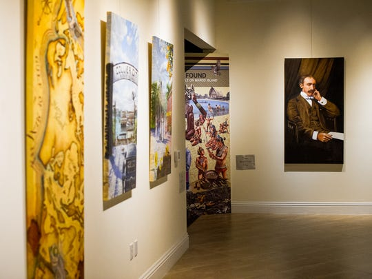 """Art from various artists hang on the walls of the Marco Island Historical Museum in Marco Island, Fla., on Wednesday, Nov. 2, 2016. The Marco Island Historical Society will present a dramatic permanent outdoor gallery called """"Windows & Doors to History"""" at the Marco Island Historical Museum starting with a preview on Nov. 10, 2016."""