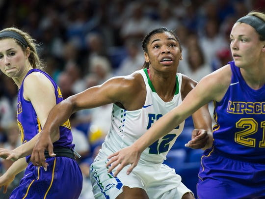 Florida Gulf Coast University's Tytionia Adderly blocks out Lipscomb's Kaylee Cottom during a game at Alico Arena in Fort Myers, Fla., on Monday, Feb. 13, 2017.