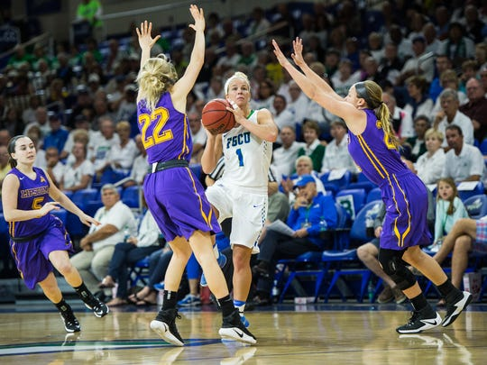 Florida Gulf Coast University's Jessica Cattani tries to get a shot off at the halftime buzzer during a game against Lipscomb at Alico Arena in Fort Myers, Fla., on Monday, Feb. 13, 2017.