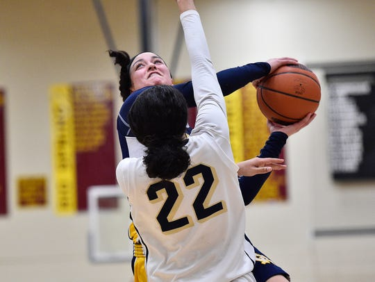 Greencastle's Jenay Faulkner shoots the ball while