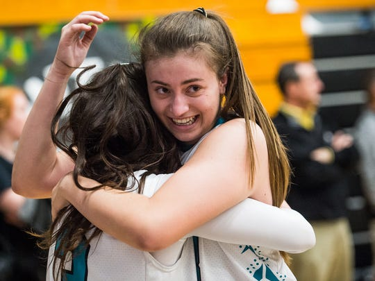 Gulf Coast High School's Marina Hodo(33) celebrates a win with Mya Giusto(3) during the Class 8A regional final over Palm Harbor University in Naples, Fla., on Thursday, Feb. 16, 2017.