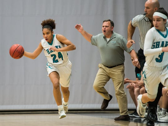 Gulf Coast High School's Yasmeen Chang brings the ball up court during the Class 8A regional final over Palm Harbor University in Naples, Fla., on Friday, Feb. 17, 2017.