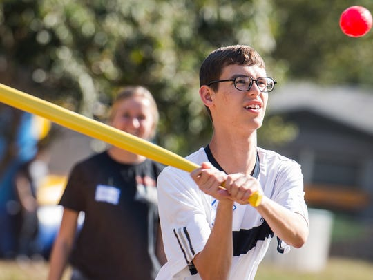 "Eli Neismith hits a pitch during a community event at the Family Initiative, Inc. Fort Myers Villas Civic Association Center in Fort Myers, Fla., on Monday, Feb. 20, 2017. For the seventh consecutive year, members of the Red Sox uniformed personnel and front-office staff performed community service for two nonprofit agencies in Lee County, Community Cooperative and The Family Initiative, Inc., during its annual Spring Training ""Day of Service."""