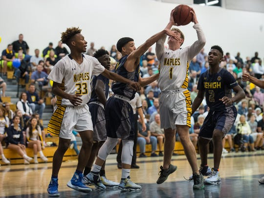 Naples High School's Joseph Sushil gets fouled on the way to the basket during a class 7A regional semifinal game against Lehigh Senior High School in Naples, Fla., on Tuesday, Feb. 21, 2017.