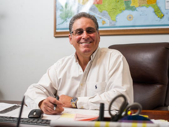 Paul Weiner, CEO of Invis-a-Beam LLC, poses for a photograph