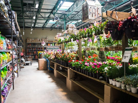 An assortment of flowers and plants are seen in the outdoor section of Orchard Supply Hardware's new store in Naples, Fla., on Monday, Feb. 27, 2017. Orchard Supply Hardware is an American retailer of home improvement and gardening products. Headquartered in San Jose, California, Orchard Supply Hardware has dozens of locations throughout California, with expansions into Oregon and now Florida.