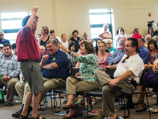 A man stands and chats during a Town-Hall meeting at  the North Collier Regional Park in Naples, Fla., on Friday, March 3, 2017. The Town-Hall meeting had a variety of questions from attendees that were directed to Congressman Francis Rooney on topics from immigration, second amendment rights, Planed Parenthood funding, and many other topics.