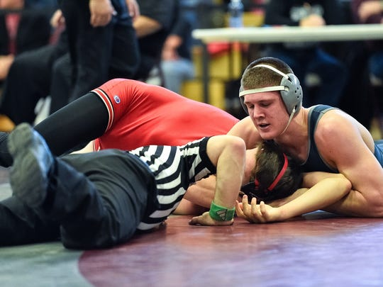Chambersburg's Drew Peck, shown scoring a pin at the Section III Tournament, hopes to improve on his fourth-place finish from a year ago at the PIAA state tournament this week.
