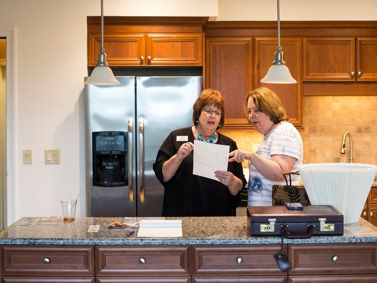 Mary Jo Zeller talks Debbie Bostock-Herts, from left to right, while moving people into a new room at Arlington of Naples, a senior living community in Naples, Fla., on Thursday, March 2, 2017. Mary Jo Zeller, director of MySolutions at the Arlington, helps families as they prepare to downsize their belongings and move into a smaller apartment.