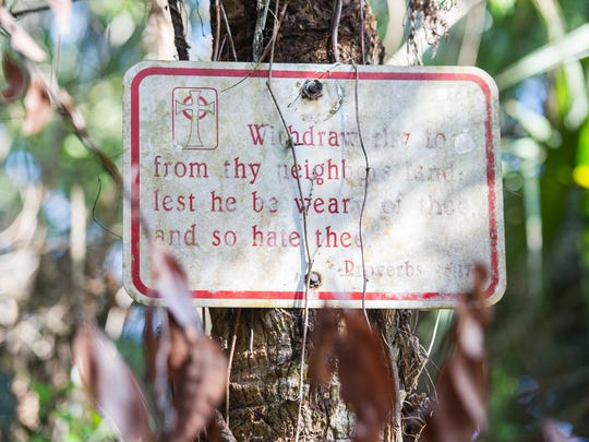 A sign hangs on a pole on the property of the late Bob Gore in Golden Gate Estates on Sunday, Feb. 26, 2017. Gore died in February, leaving questions about the fate of his life's work, a wildlife sanctuary he created parcel by parcel with his own money and used to educate schoolkids about nature and host folk music festivals.