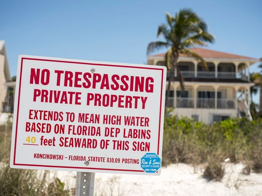 """""""No Trespassing"""" signs stand in front of homes near the Little Hickory Island area of Bonita Springs on Friday, April 7."""
