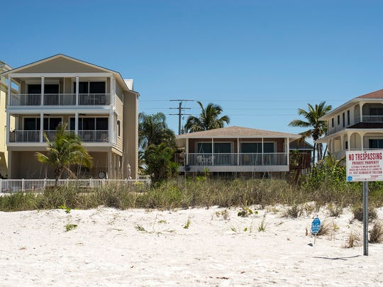 """""""No Trespassing"""" signs stand in front of homes near the Big Hickory Island area of Bonita Springs on Friday, April 7."""