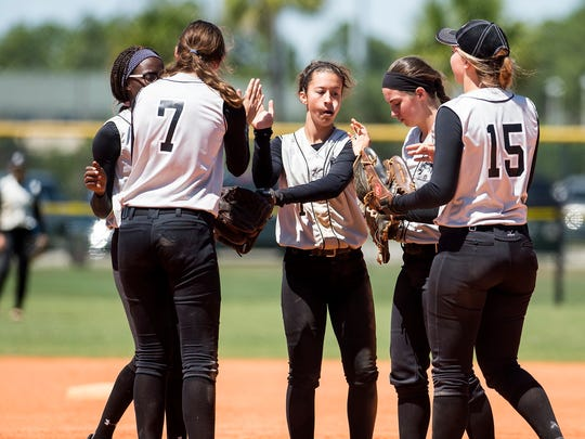 Robinson High School celebrates a good inning against Treasure Coast High School at the Bill Longshore Memorial Softball Tournament at North Collier Regional Park in Naples, on Saturday, April 8, 2017.