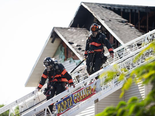 North Collier Fire Rescue crews put out hot spots during