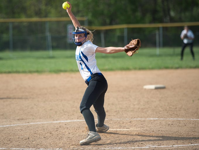 McConnellsburg's Carly Swope pitches during a softball