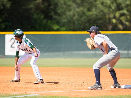 Seacrest Country Day School's Josue Rivera leads off of first base during a class 2A regional semifinal at Seacrest Country Day School in Naples, Fla., on Wednesday, May 10, 2017.