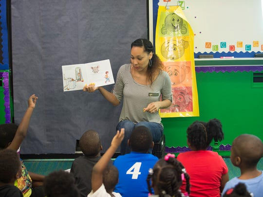 Nina Mothershed, a Kindergarten Teacher, reads to students