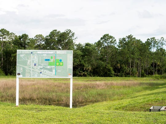 A map with information sits in a field on Thursday,