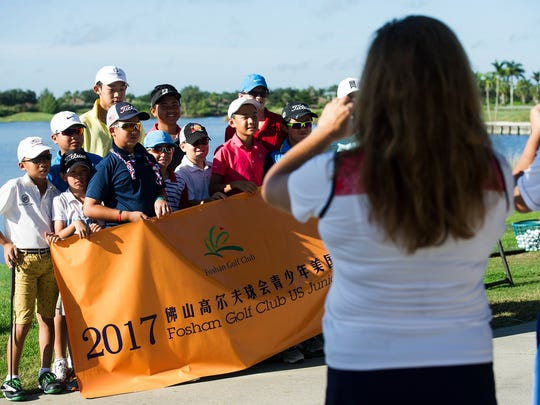 Junior golfers from China and juniors from The First Tee of Naples/Collier at Heritage Bay Golf & Country Club in Naples, Fla., on Monday, Aug. 7, 2017.