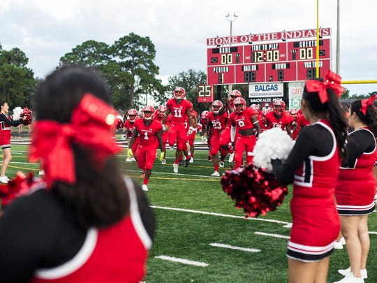 Immokalee charges the field before a game against visiting Gulf Coast High School on Friday, August 18, 2017.