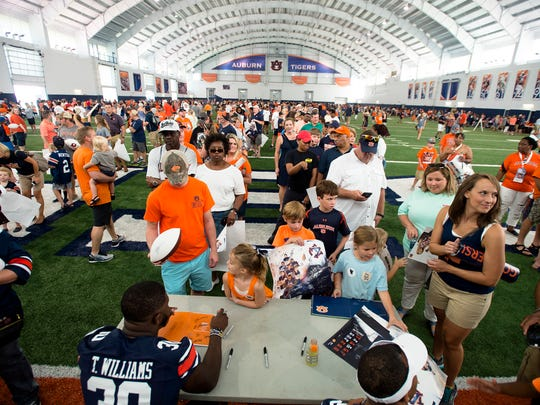 Auburn's Tre Williams signs items for fans during Auburn Fan Day in Auburn, Ala., on Saturday, Aug. 19, 2017.