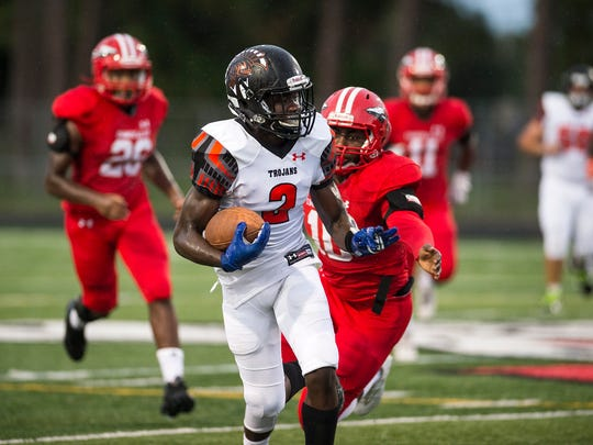 Lely High School's Nelson Charles takes the ball up field during a game against Immokalee High School in Immokalee, Fla., on Friday, Sept. 1, 2017.