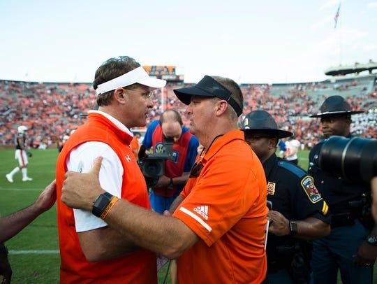 Auburn head coach Gus Malzahn greets Mercer head coach