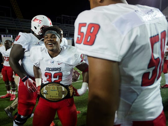 South Alabama running back Tra Minter (32) wears The Belt after the Troy vs South University NCAA football game on Wednesday, Oct. 11, 2017, in Troy, Ala. South Alabama defeated Troy 19-8.