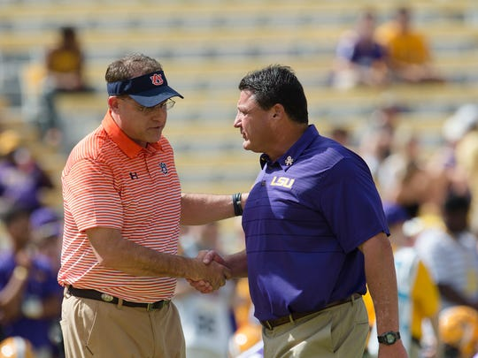 Auburn head coach Gus Malzahn greets LSU head coach Ed Orgeron before the NCAA football game between Auburn and LSU on Saturday, Oct. 14, 2017, at Tiger Stadium in Baton Rouge, La.