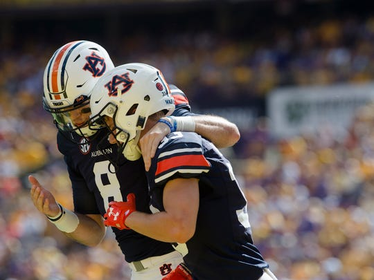 Auburn quarterback Jarrett Stidham (8) celebrates with wide receiver Will Hastings (33) after they connected for a touchdown against LSU on Saturday, Oct. 14, 2017, at Tiger Stadium in Baton Rouge, La.