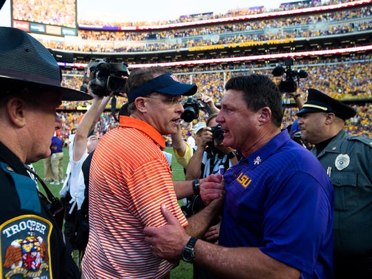 Auburn head coach Gus Malzahn greets LSU head coach Ed Orgeron after after the NCAA football game between Auburn and LSU on Saturday, Oct. 14, 2017, at Tiger Stadium in Baton Rouge, La. LSU defeated Auburn 27-23.